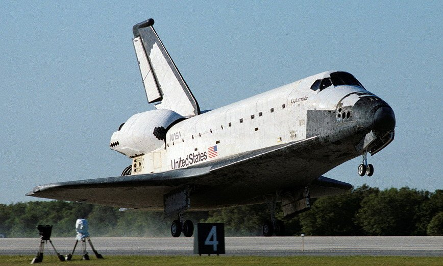 Sky background, white & black Columbia Space shuttle as wheels touched down at Kennedy Space Center