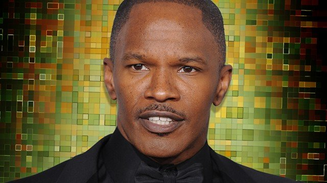 green and brown background with Texas actor Jamie Foxx in foreground dressed in black bowtie and black jacket