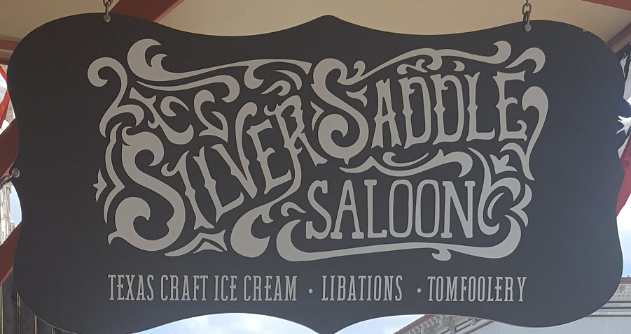 Swinging sign for The Silver Saddle Saloon in Granbury, TX