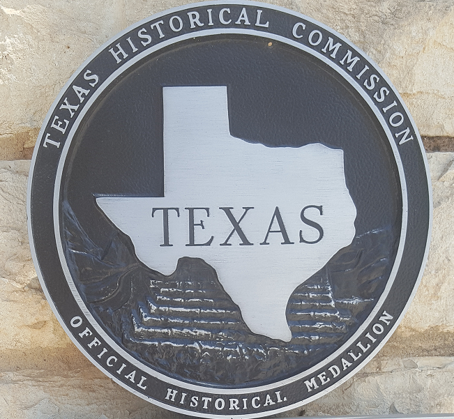 Texas Historical Commission Official Medallion that decorates the outside of recognized historical buildings throughout Texas.